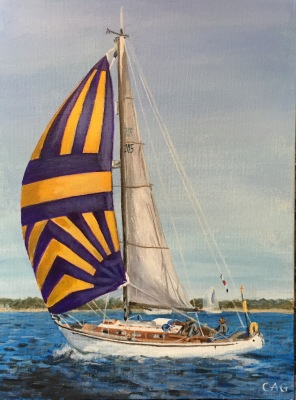 Yacht sailing with spinnaker in full sail