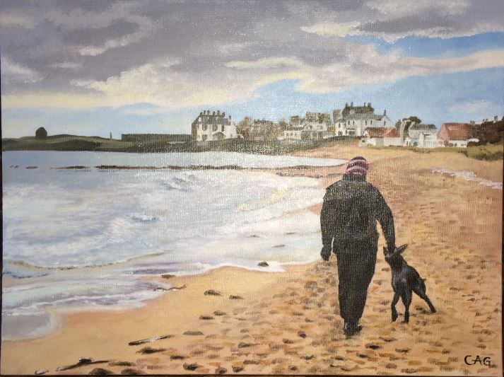 Graham walking his dog on the beach at Elie, cloudy sky, sand, sparking water